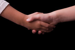 Children shaking hands Stock Photography