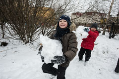 Children shape and painting the snowman. royalty free stock photos