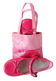 Children shoes and handbag on a white background Royalty Free Stock Photos