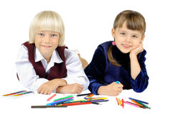 Children shool. Two  fun little children  lie with pencil  and smile, on white background, isolated Stock Images