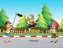 Children shooting boy playing skateboard. Illustration Stock Images