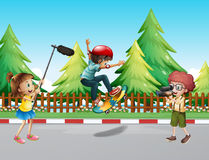 Children shooting vdo with boy skateboarding. Illustration Stock Photo