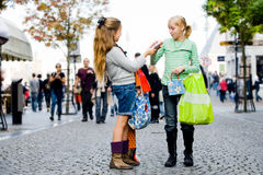 Children are shopping. Two young children hanging around the streets while shopping Stock Photos