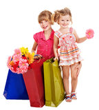 Children with shopping bag. Happy little girl with shopping bag. Isolated Royalty Free Stock Photography