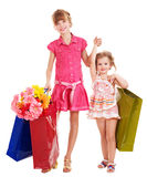 Children with shopping bag. Happy little girl with shopping bag. Isolated Royalty Free Stock Images