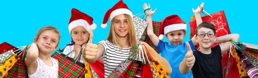 Children with shopping bags. Christmas. Little children in fur-caps with shopping bags. Sales and Christmas Stock Photography