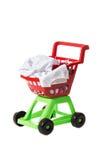 Children shopping cart full of clothing Royalty Free Stock Image
