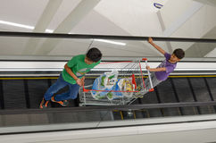 Children in Shopping Mall with Shopping Cart. Children holding a shopping cart in Emporium Mall, Lahore, Pakistan Royalty Free Stock Photography