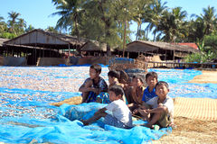 Children on the shore of Bengal bay, Myanmar Royalty Free Stock Images