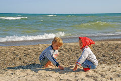 Children on the shores of Lake Michigan, Indiana, USA. Boy and girl play on the shore of Lake Michigan, Indiana, USA Royalty Free Stock Photo