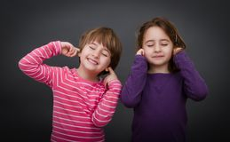 Children shout the ears. Children expression and emotion in gray background Royalty Free Stock Images