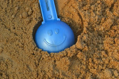Children shovel smile. Baby in the sandbox shovel smile childhood Stock Photo
