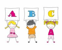 Children showing alphabet Stock Images