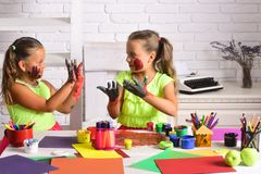 Children showing colored hands Stock Image