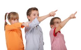 Children showing a finger in the corner Royalty Free Stock Image