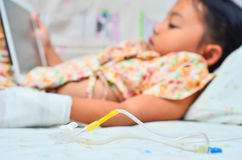 Children sick. The little girl sick and stay on the bed Stock Photo