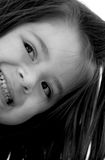 Children - Side Cheese. Black and white image of a little girl smiling on an angle Royalty Free Stock Photos