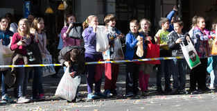 Children  on the sidewalk waiting for caramels Royalty Free Stock Photos