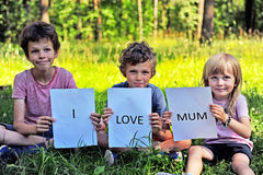 Children with the sign I love mum Stock Image