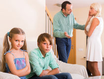 Children in silence while parents arguing Royalty Free Stock Images