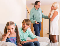 Children in silence while parents arguing Stock Photo