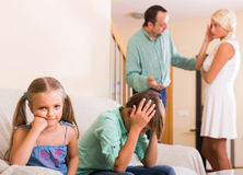Children in silence while parents arguing Stock Image