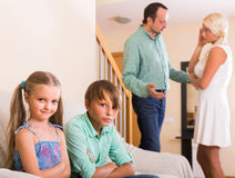 Children in silence while parents arguing Stock Photos