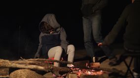 Children silhouette girl kids teen sit by the fire at night campfire. travel hiking adventure camping adventure camping. Children silhouette girl kids teen sit stock footage