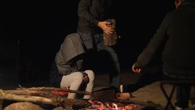 Children silhouette girl kids teen sit by the fire at night campfire. travel hiking adventure camping adventure camping. Children silhouette girl kids teen sit stock video