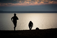 Children silhouette. Children running at beach of the dead sea at sunset time Royalty Free Stock Photos