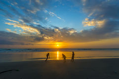 Children silhouette and sunrise. Sunrise with children playing silhouette foreground Stock Photo