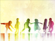 Children silhouettes dancing together Royalty Free Stock Photo
