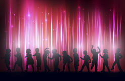Children silhouettes dancing together Stock Image