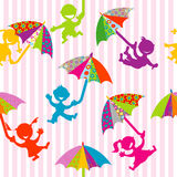 Children silhouettes with doodle umbrellas Royalty Free Stock Images