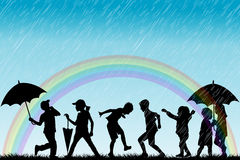 Children silhouettes enjoy the rain Stock Photography