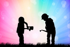 Children silhouettes in the garden Royalty Free Stock Photo