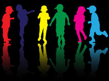 Children silhouettes. Happy girls and boys Stock Image