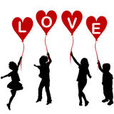 Children silhouettes with heart balloons and word LOVE Royalty Free Stock Photos