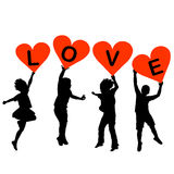 Children silhouettes with heart shaped banners Stock Images