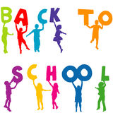 Children silhouettes holding letters with BACK TO SCHOOL Royalty Free Stock Photo