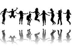 Children silhouettes jumping Royalty Free Stock Images