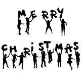 Children silhouettes with Merry Christmas message Royalty Free Stock Images