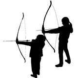 Children silhouettes playing archery Stock Photos