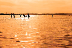 Children silhouettes playing in Balaton Lake Royalty Free Stock Photo