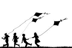 Children playing with kites. Children silhouettes playing with kites Royalty Free Stock Photos