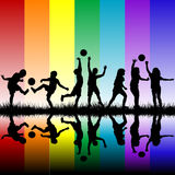Children silhouettes playing on rainbow background Stock Image