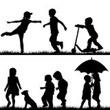 Children silhouettes playing Stock Photos