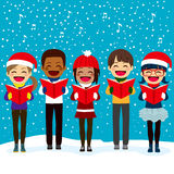 Children Singing Carols At Christmas. Happy children friends from different ethnicities singing carols at Christmas night Royalty Free Stock Photos