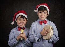 Children singing Christmas carols. At Christmas royalty free stock images