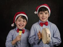 Children singing Christmas carols. At Christmas stock photography